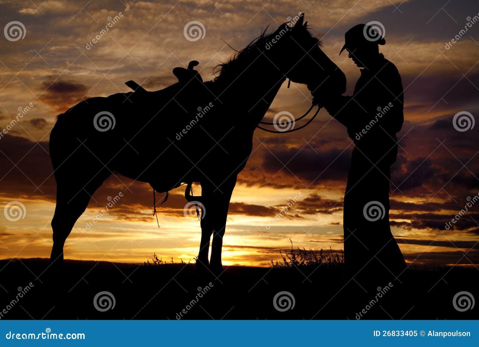 Soporte de la puesta del sol del caballo del vaquero