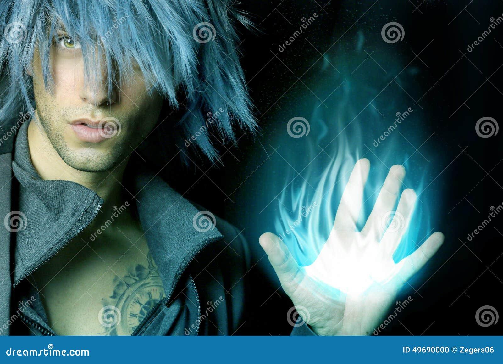 Sorcier beau qui crée un aérolithe bleu