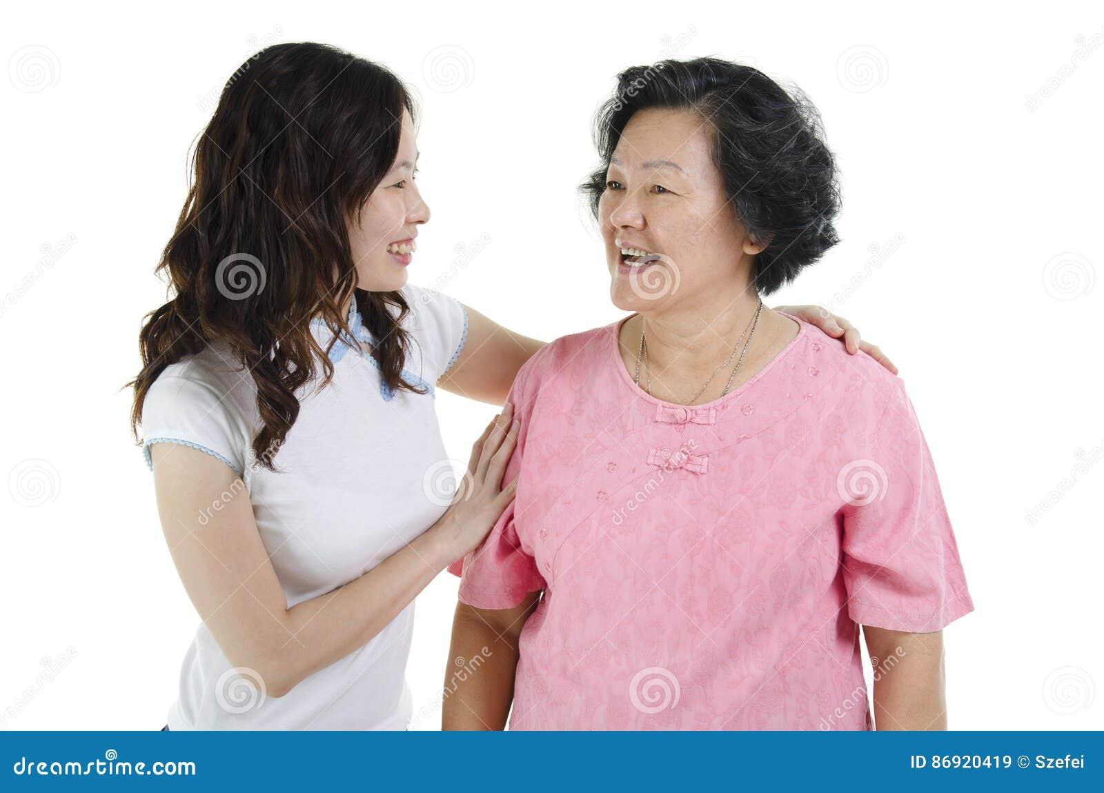 Sorriso superior da filha da matriz e do adulto