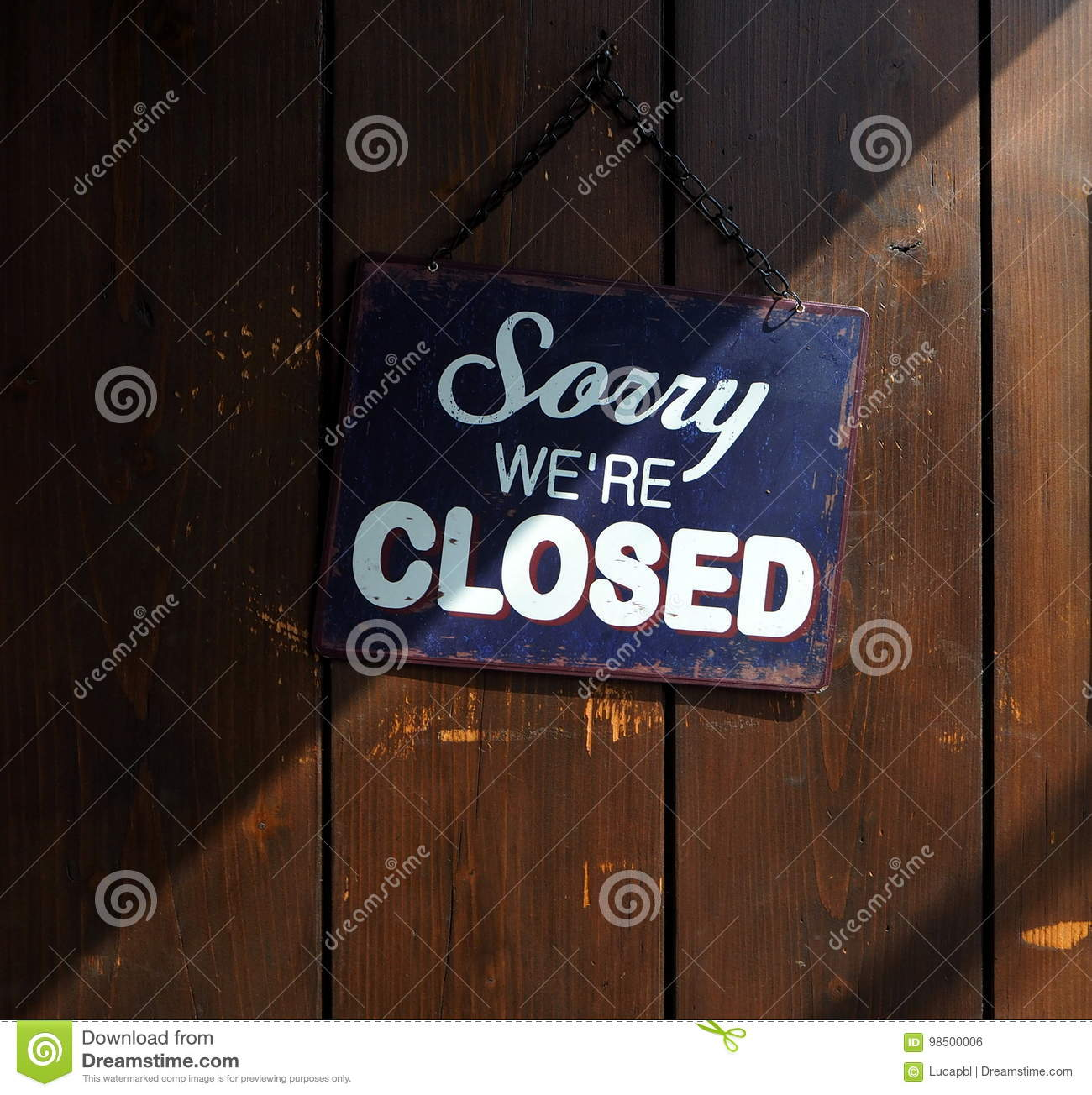 Sorry We`re Closed, Blue And White Sign On Old Wooden Door