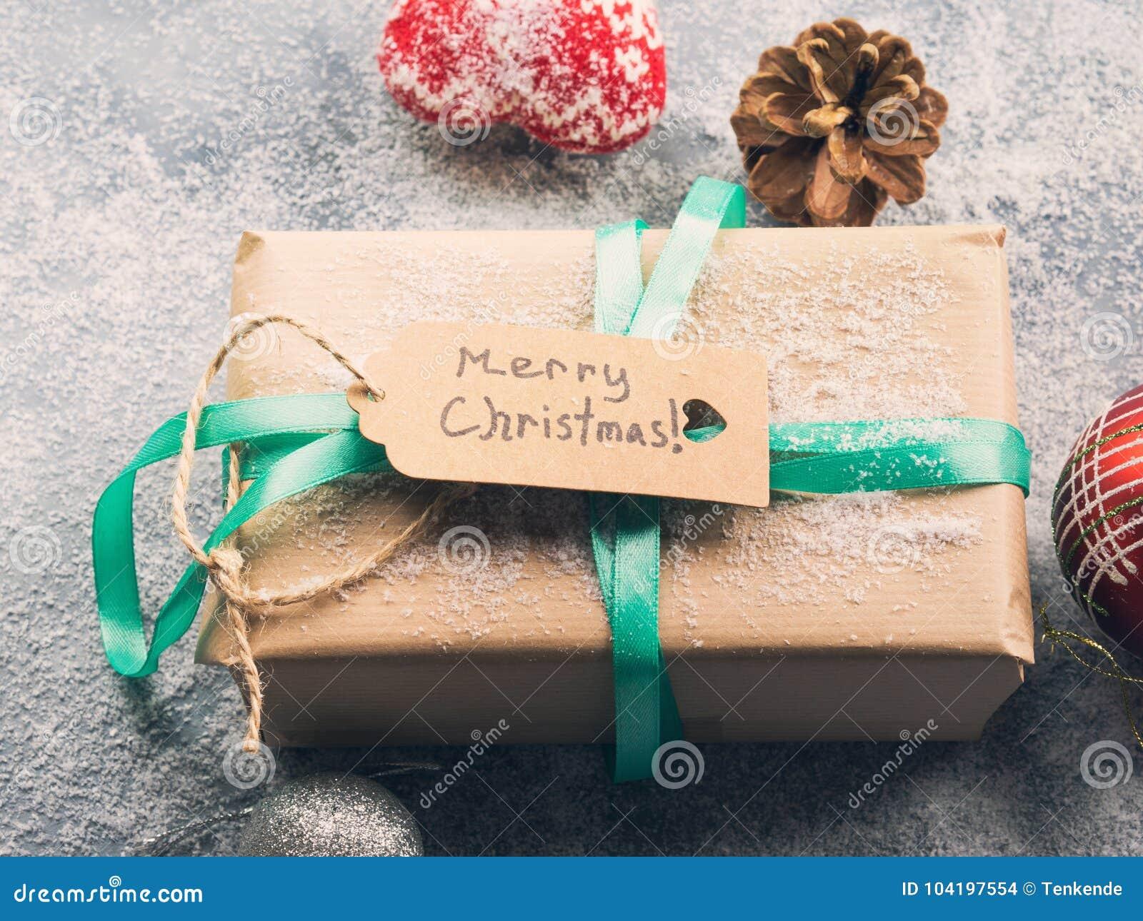 Souhait du fond de Joyeux Noël avec le cadeau