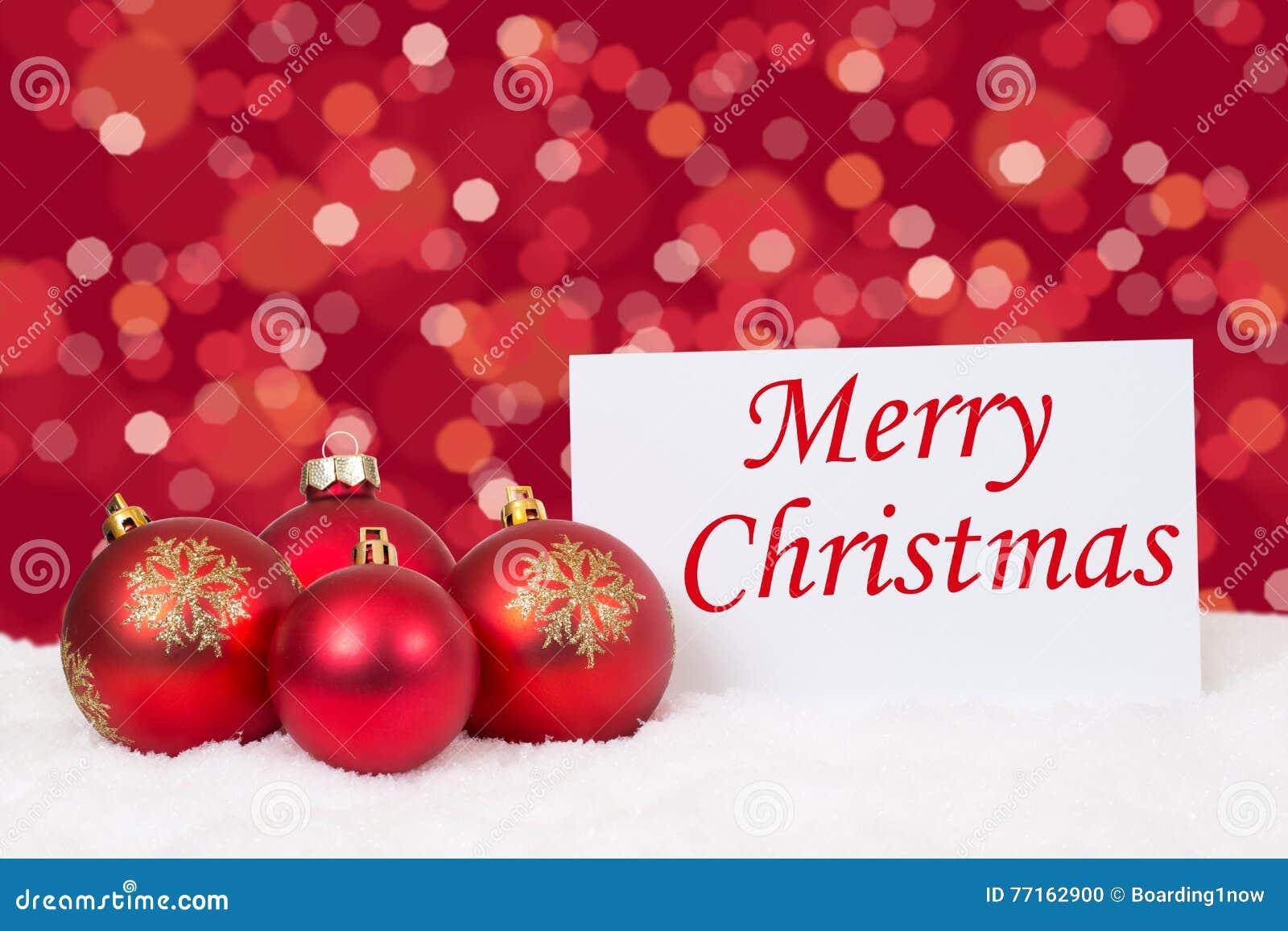 Souhaits rouges de carte de boules de Joyeux Noël