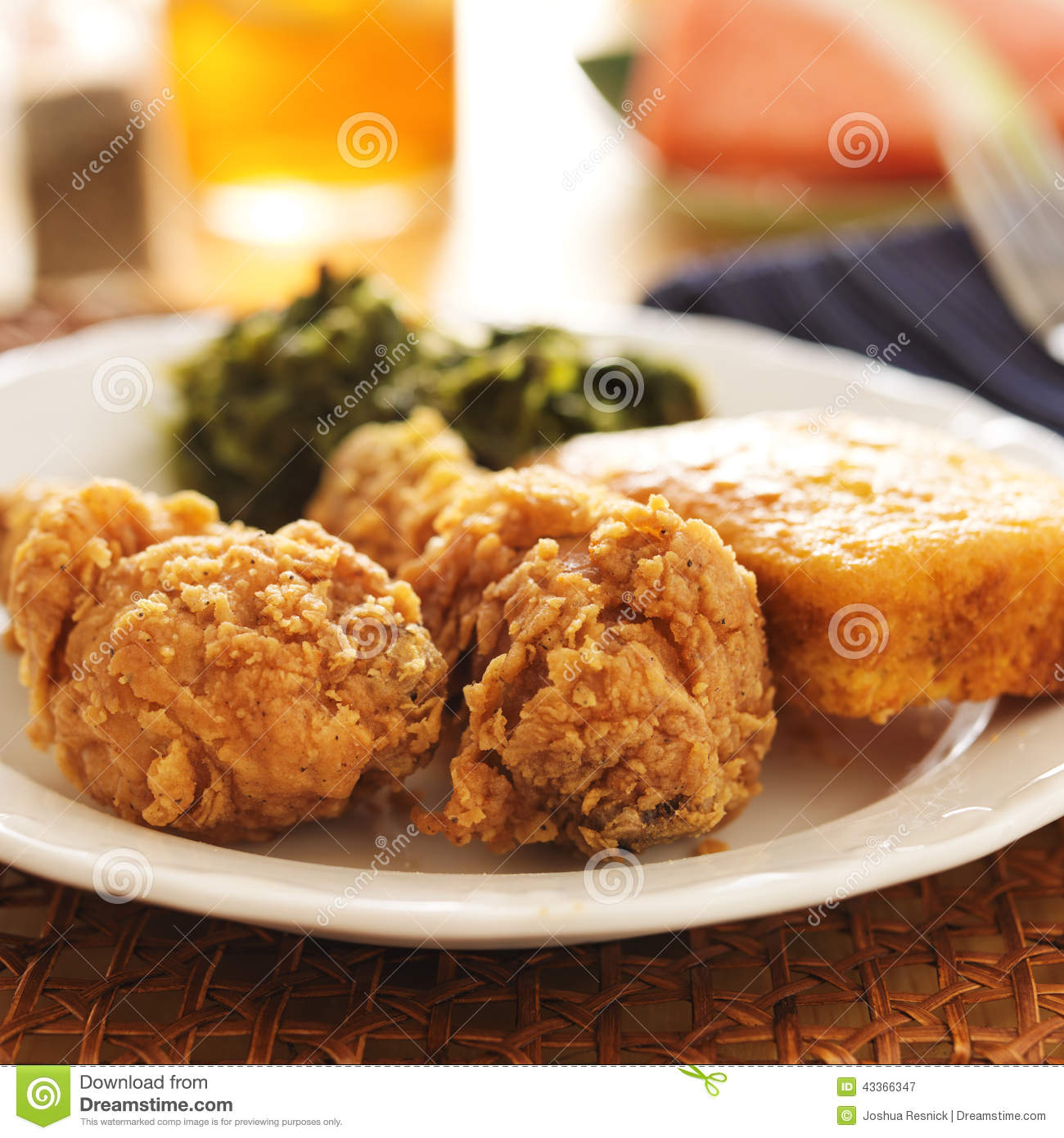 Soul food fried chicken with collard greens and corn for American style cuisine