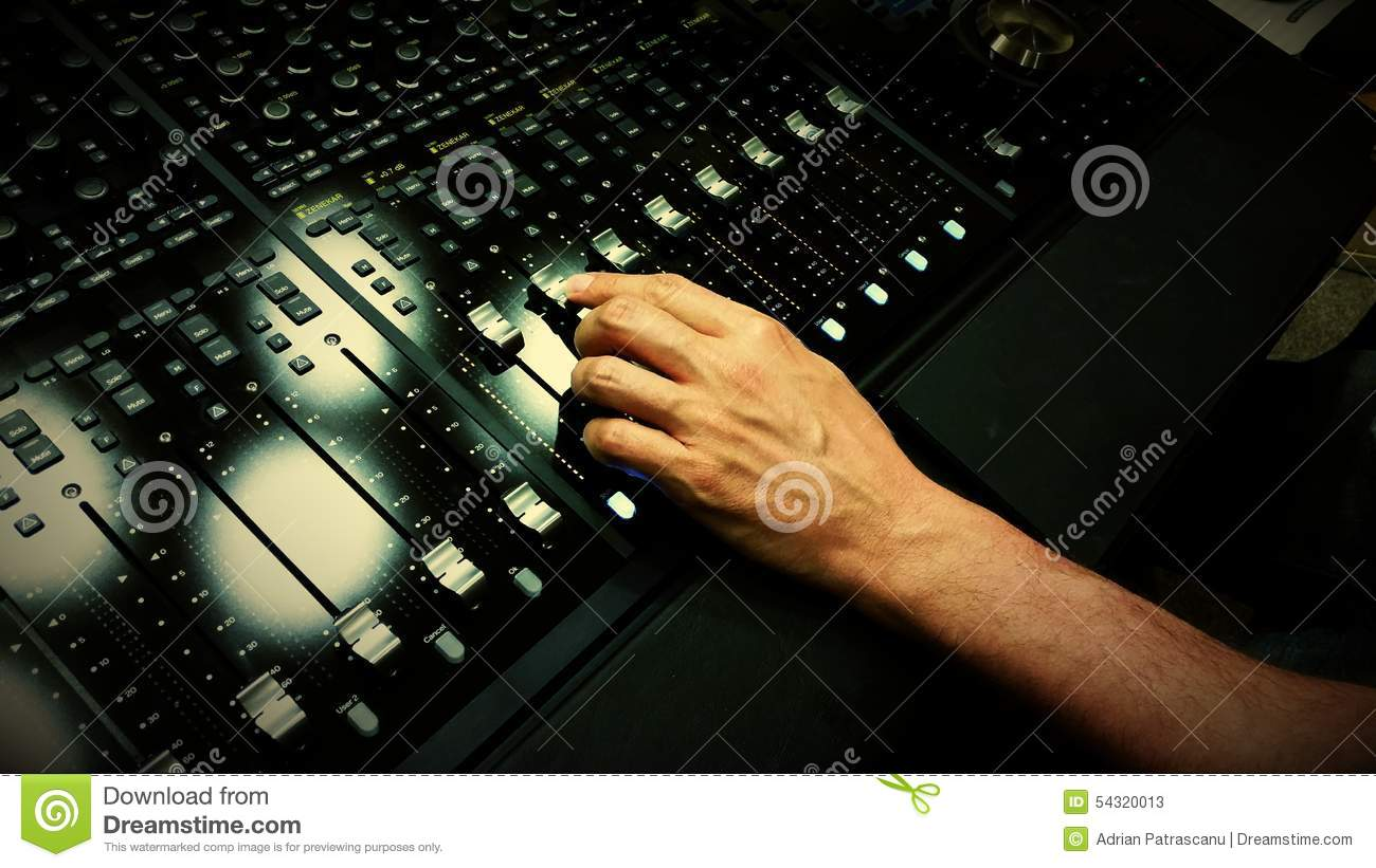 Sound Engineer Mixing At Audio Mixing Desk Stock Image