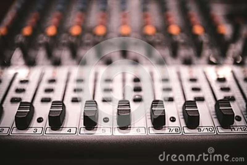 Sound studio recording equipment, music mixer controls at concert or party in a night club. Soft effect on photo