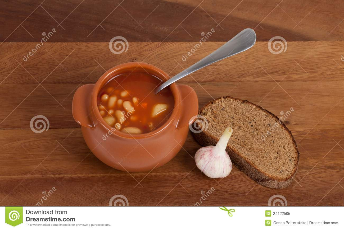 Soup In Clay Pot With Bread And Garlic Royalty Free Stock ...