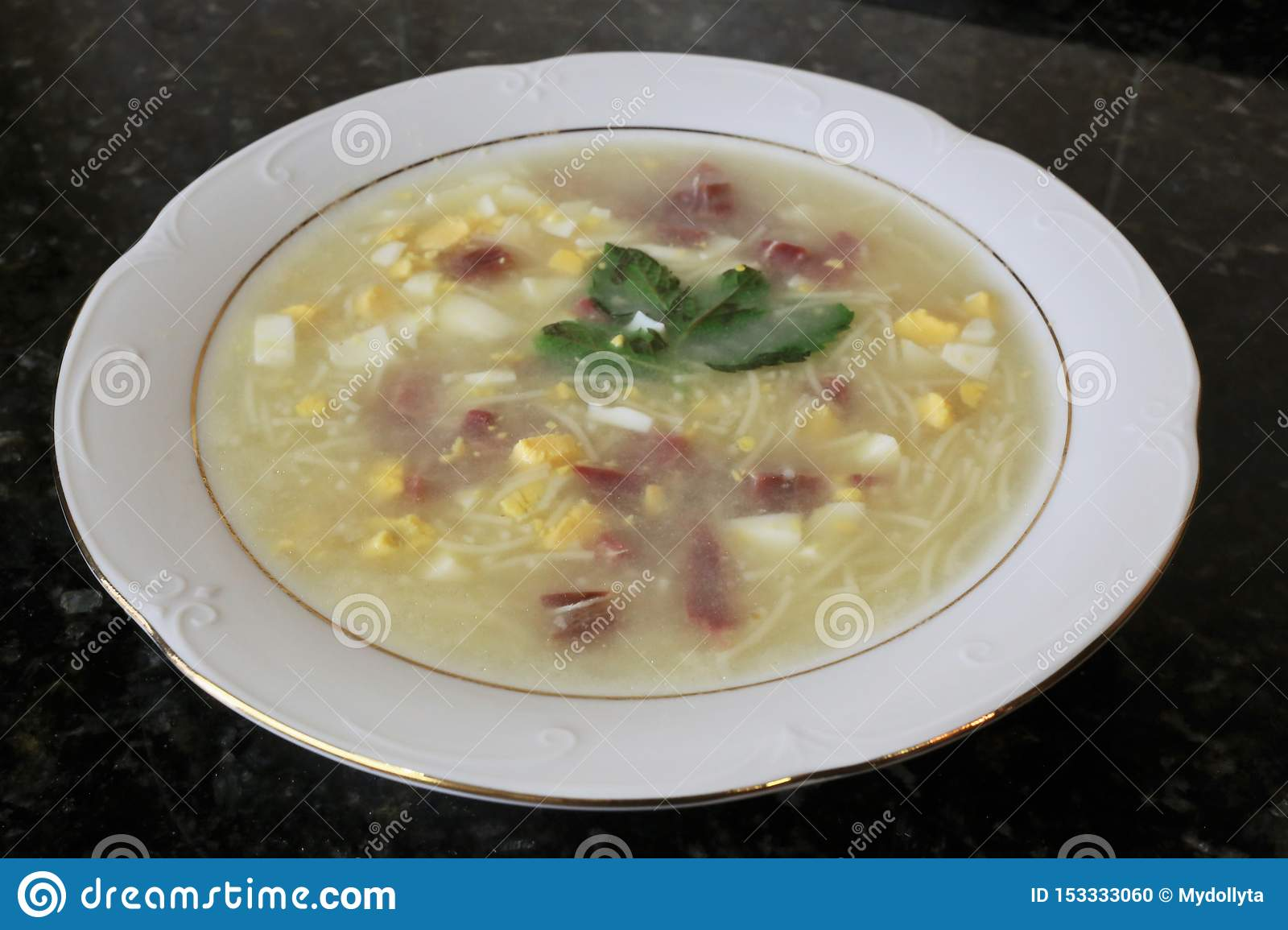 The soup with egg and ham noodles typical Andalusian and Spanish