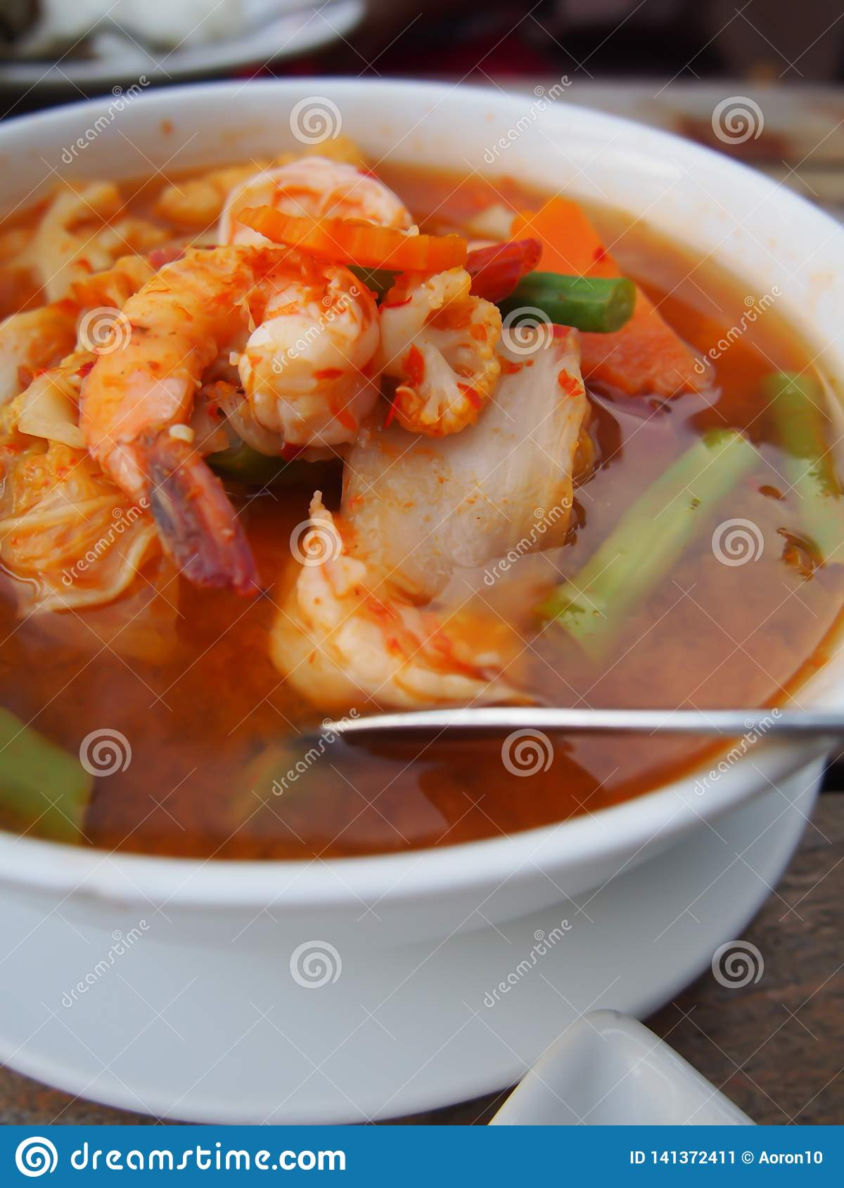 Sour curry with vegetables such as white cabbage and long bean and shrimp, Thai food.