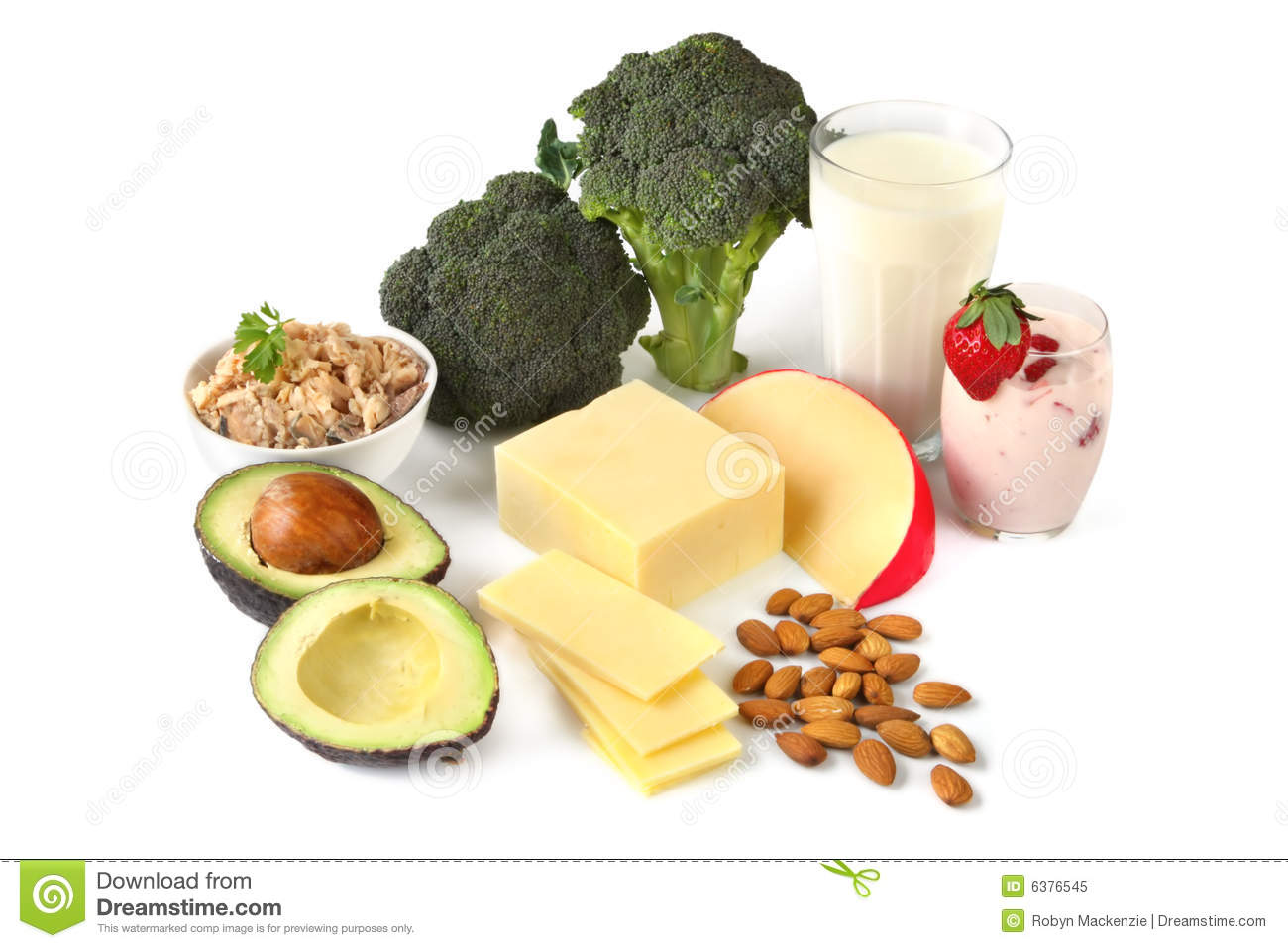 Calcium-rich foods, on white background. Includes avocado, salmon ...