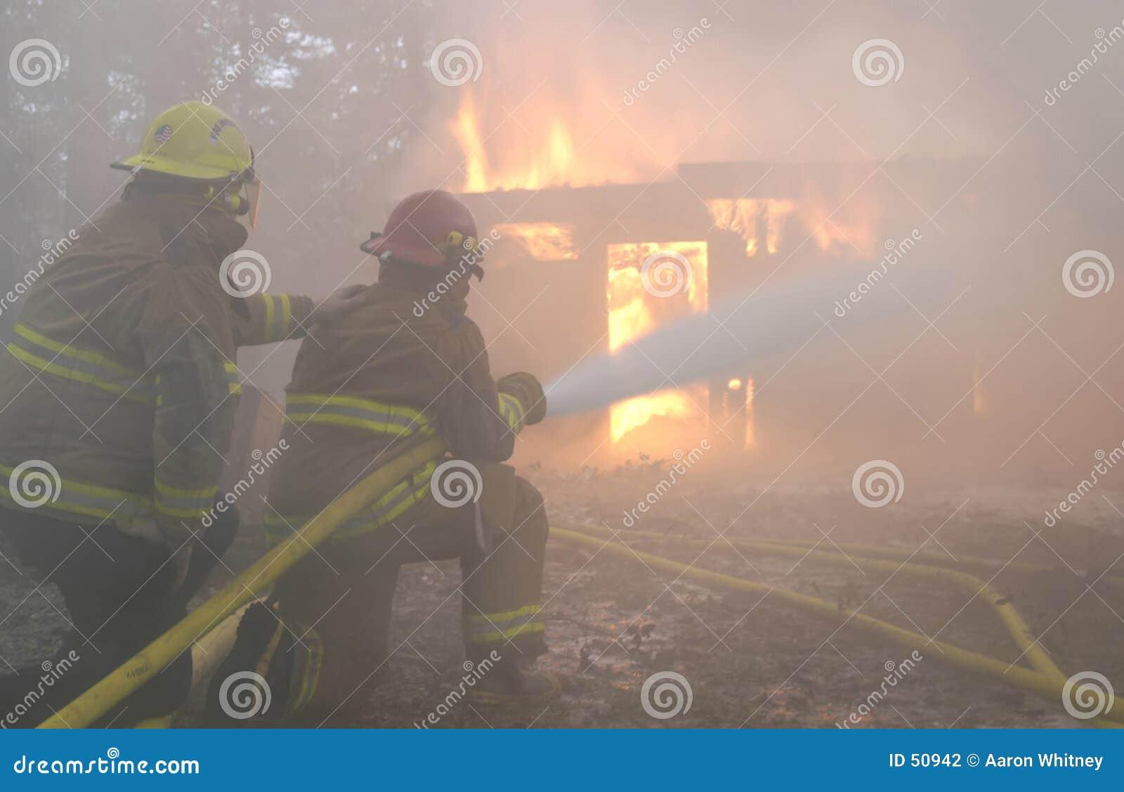 Download Sous le contrôle photo stock. Image du incendie, pompiers - 50942