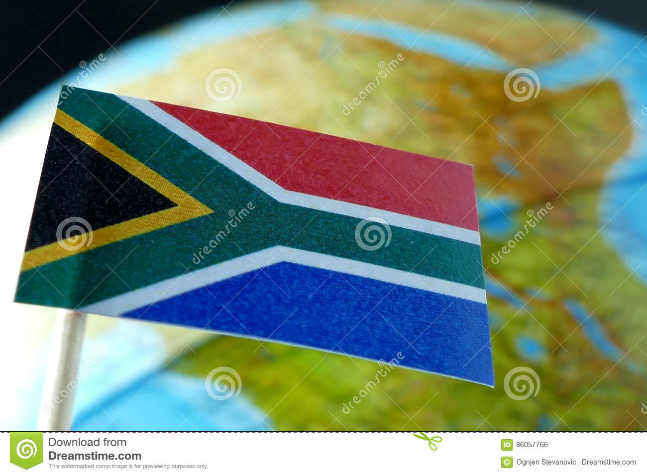 South Africa flag with a globe map as a background
