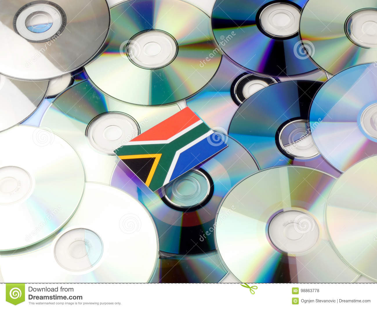 South African flag on top of CD and DVD pile isolated on white