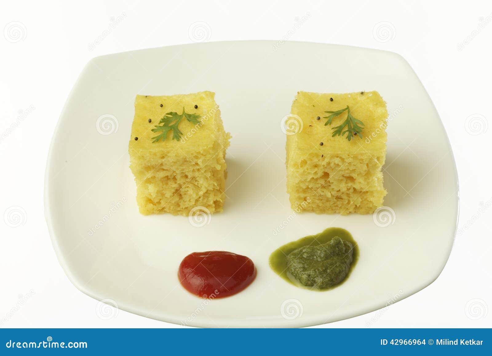 ... gujarati-lentil-cake-dhokla-plate-tomato-ketchup-chutney-42966964.jpg