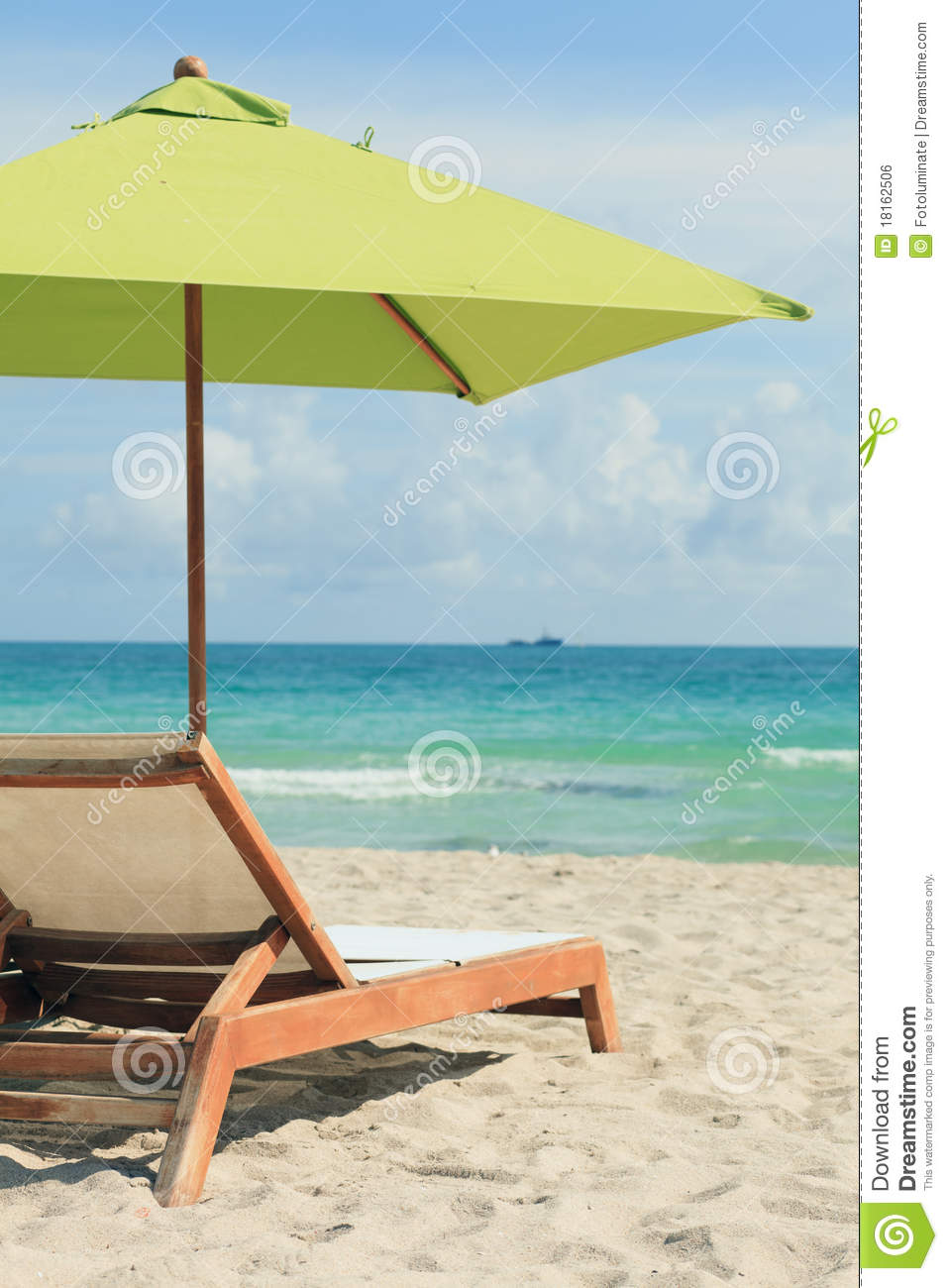 Beach umbrella and chair - South Beach Umbrella And Lounge Chair Royalty Free Stock Image