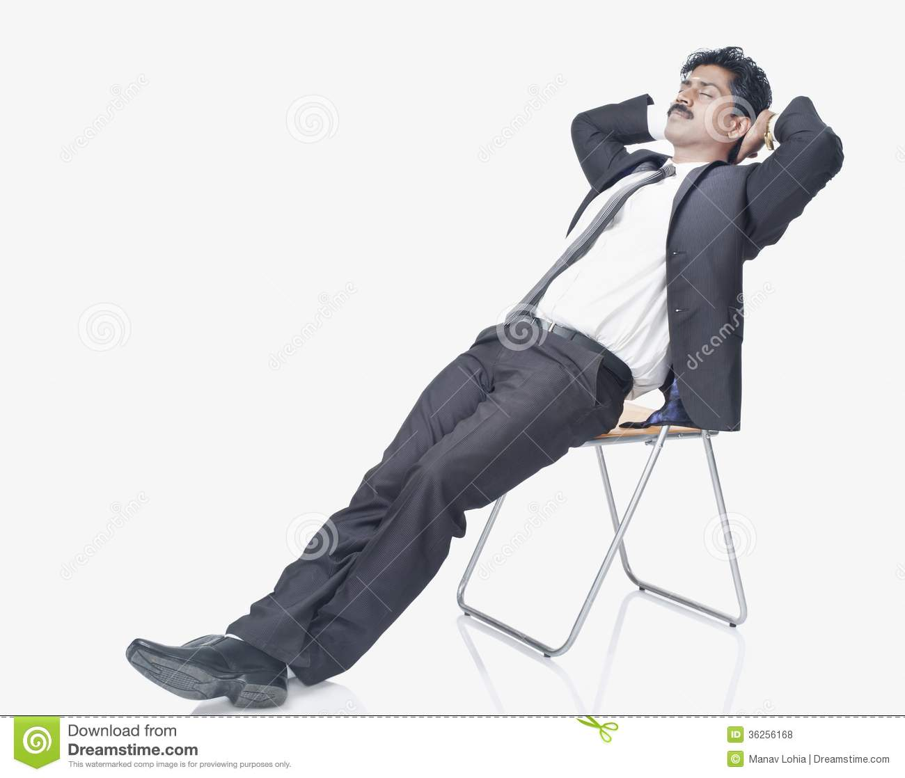South Indian Businessman Resting On A Chair Royalty Free