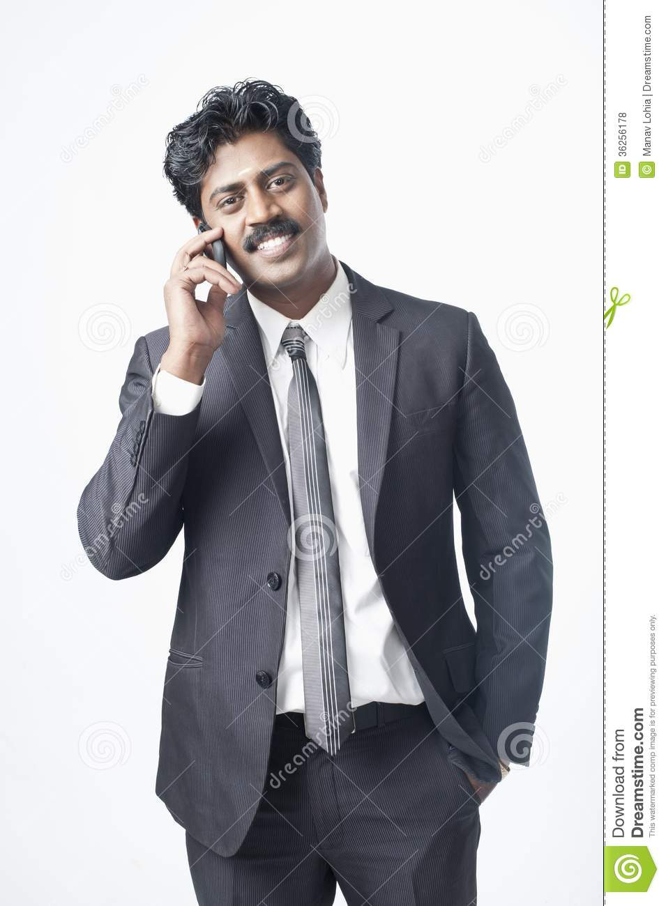 7b3f5b1090 South Indian Businessman Talking On A Mobile Phone Stock Photo ...