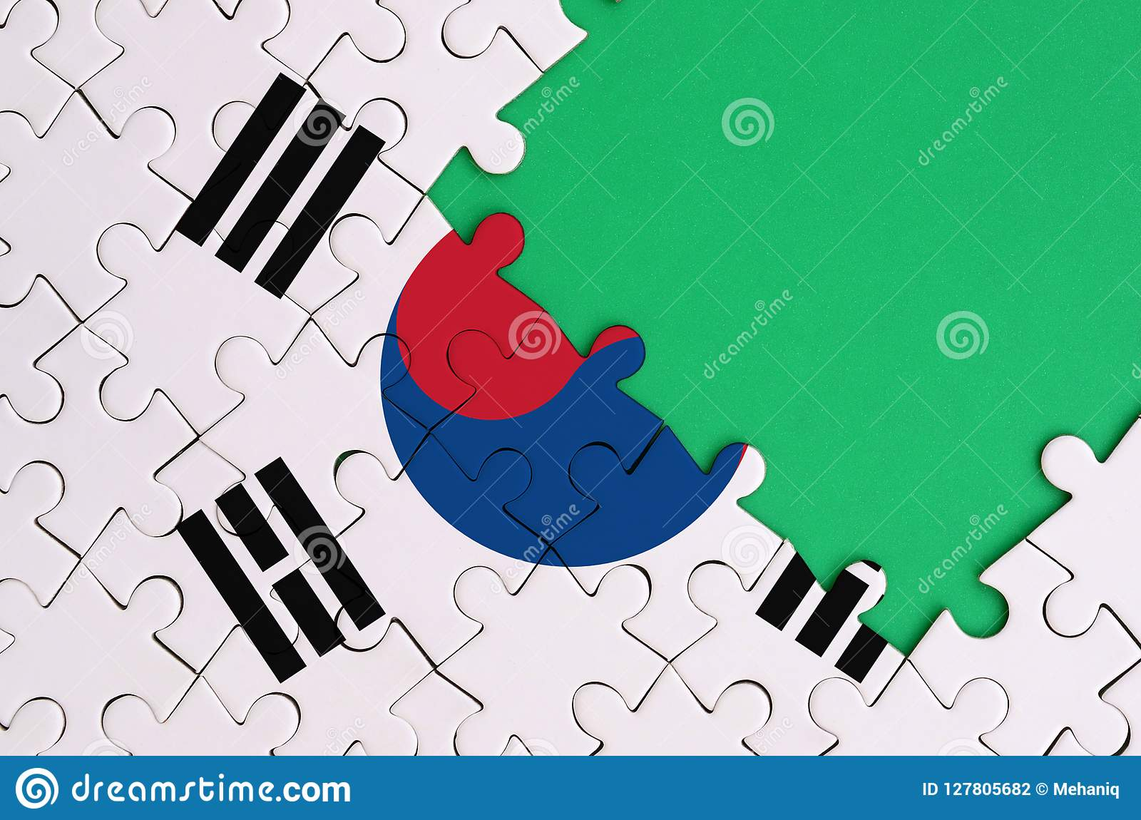 South Korea flag is depicted on a completed jigsaw puzzle with free green copy space on the right side