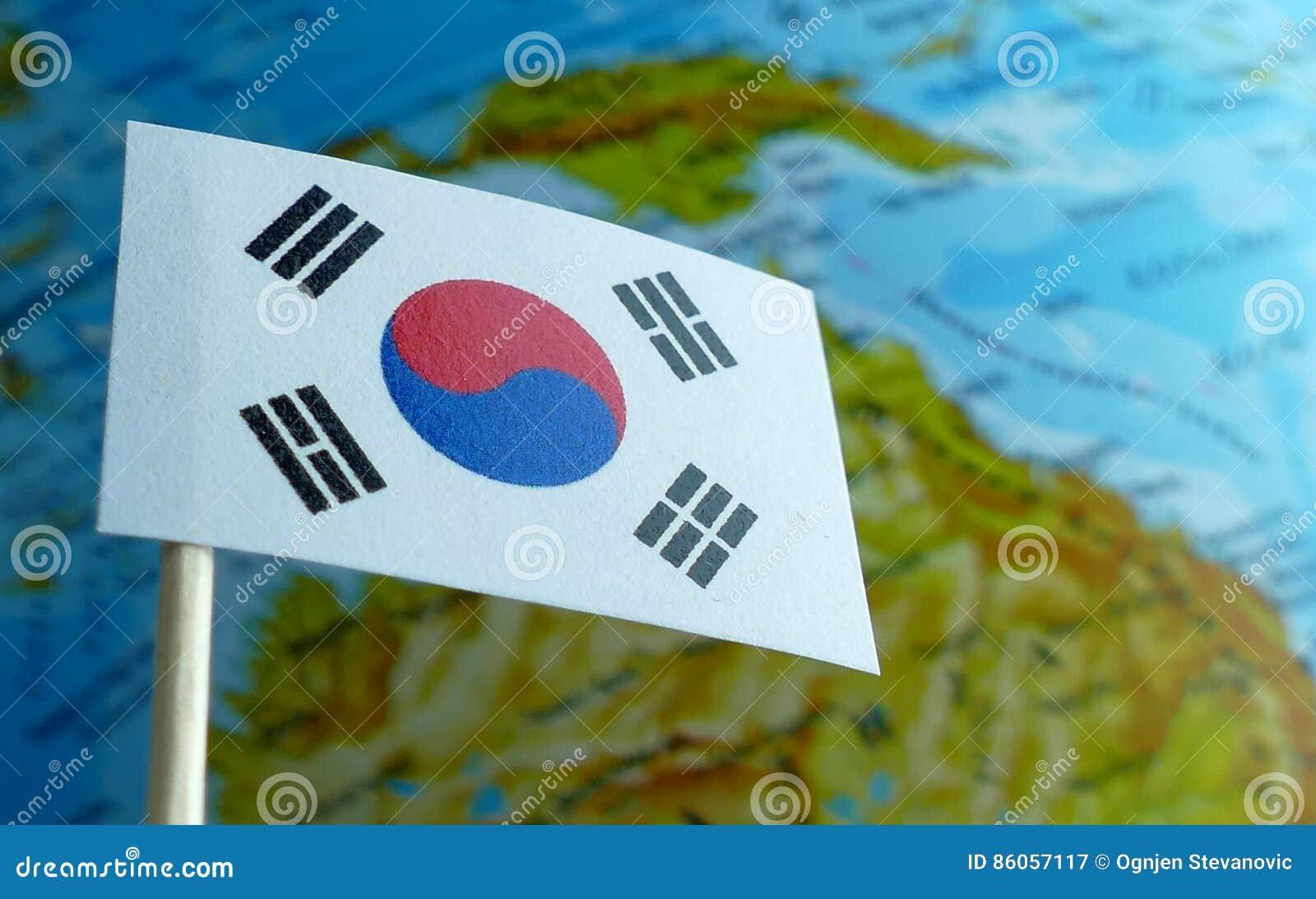 South Korea flag with a globe map as a background