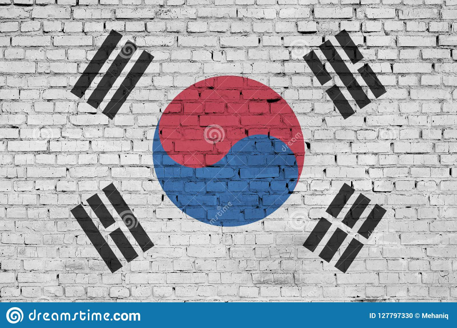 South Korea flag is painted onto an old brick wall