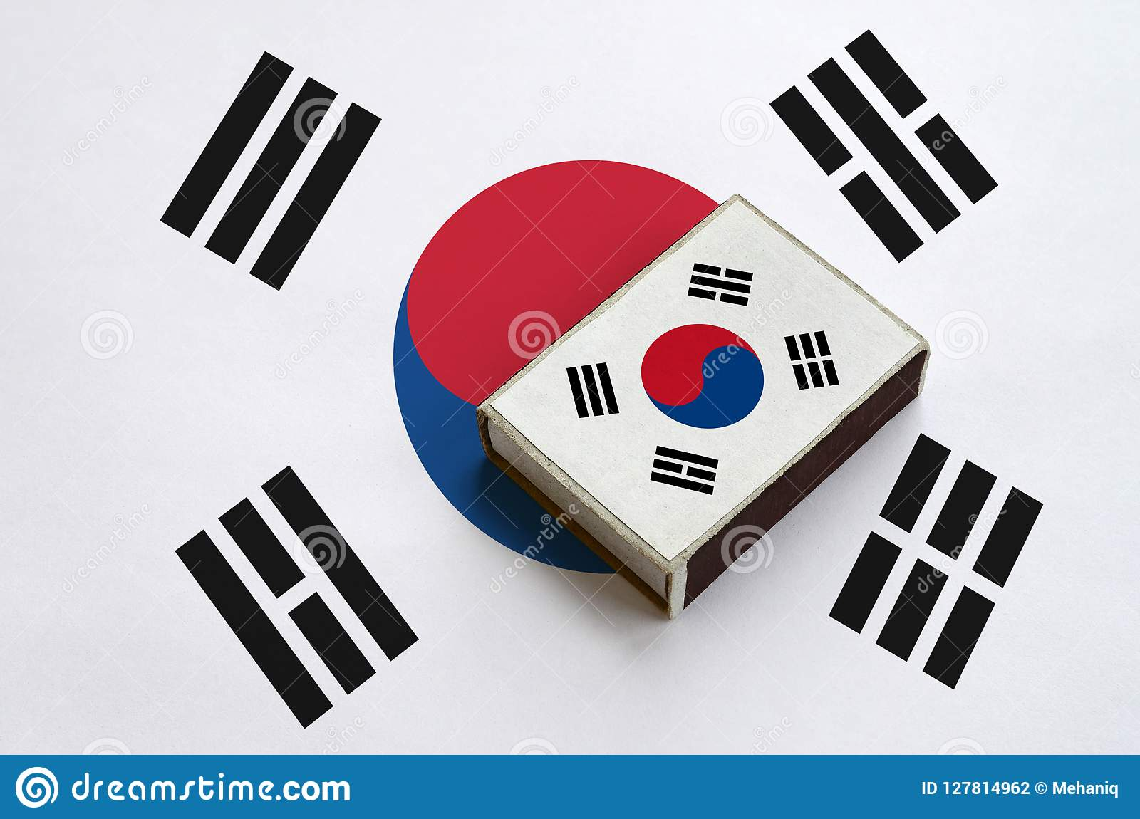 South Korea flag is pictured on a matchbox that lies on a large flag