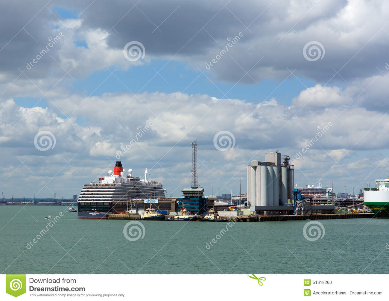 Southampton Docks With Big Cruise Ship And Cargo Vessel On Calm Summer Day With Fine Weather