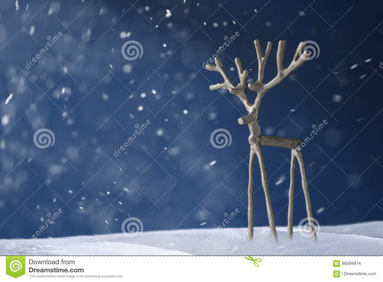 Souvenir Silver Deer On A Blue Background In Snow Stock