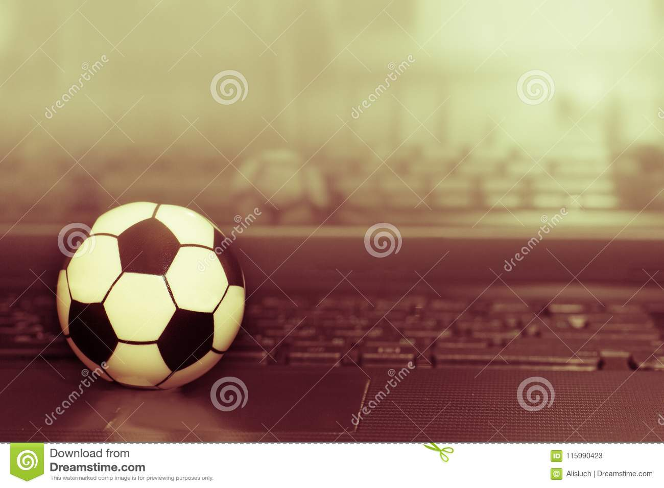 Souvenir Soccer Ball On The Laptop Keyboard The Concept Of A