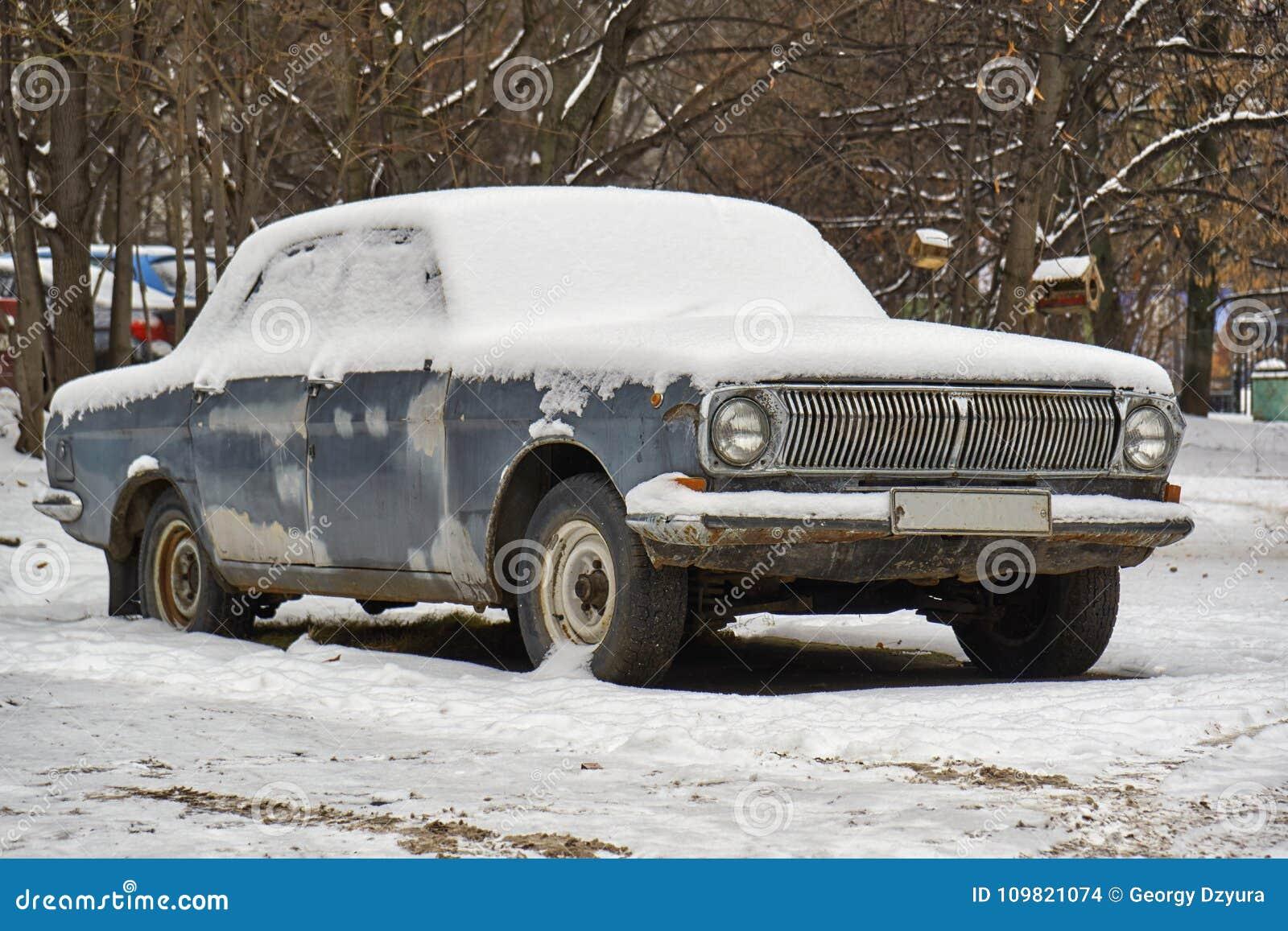 Soviet retro car Volga abandoned on the street