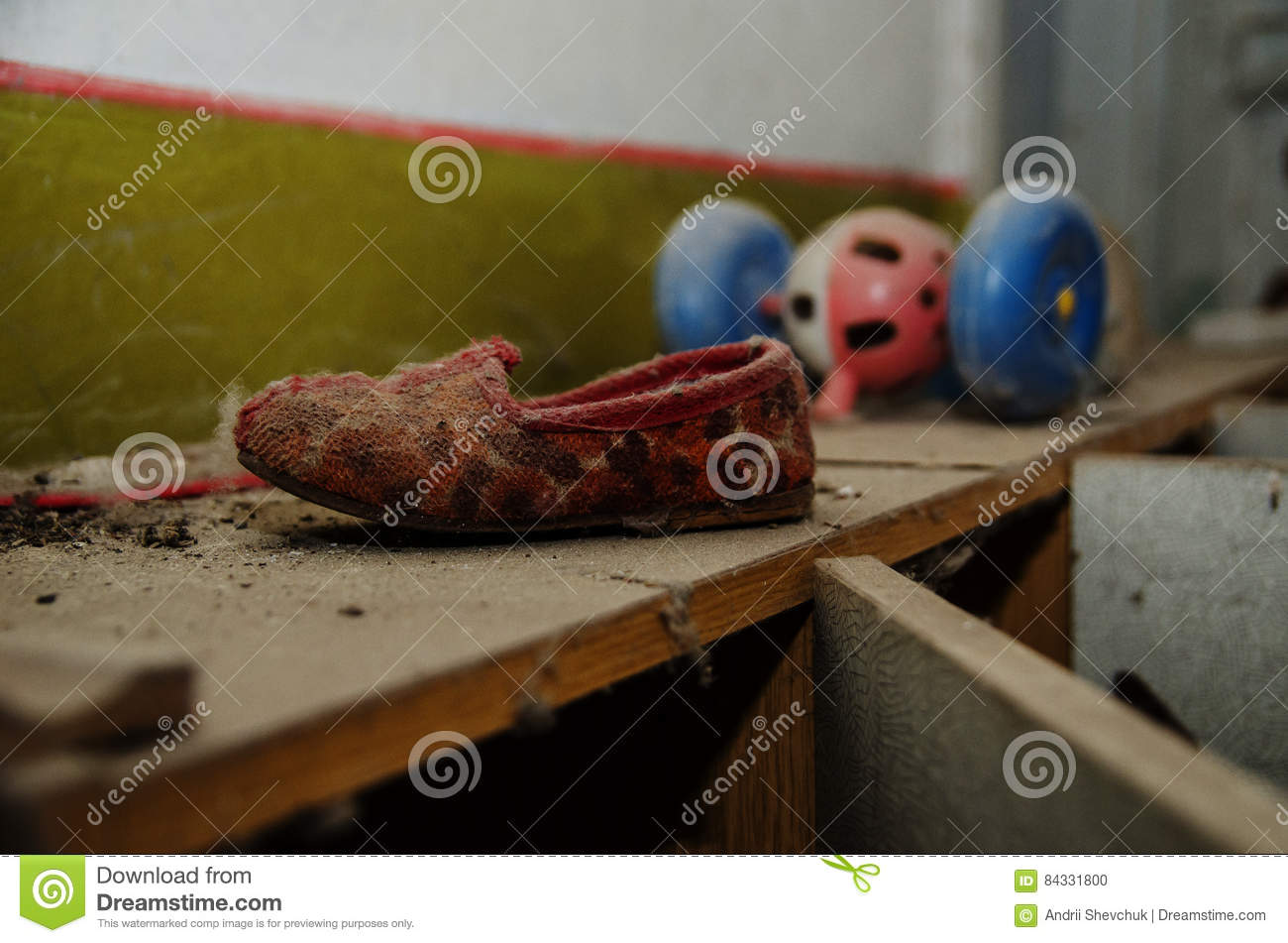 Soviet shoes children slippers in dust at Chernobyl nuclear disaster area.