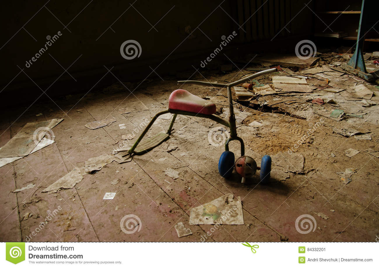 Soviet toys of rusty baby bike in Chernobyl nuclear disaster are