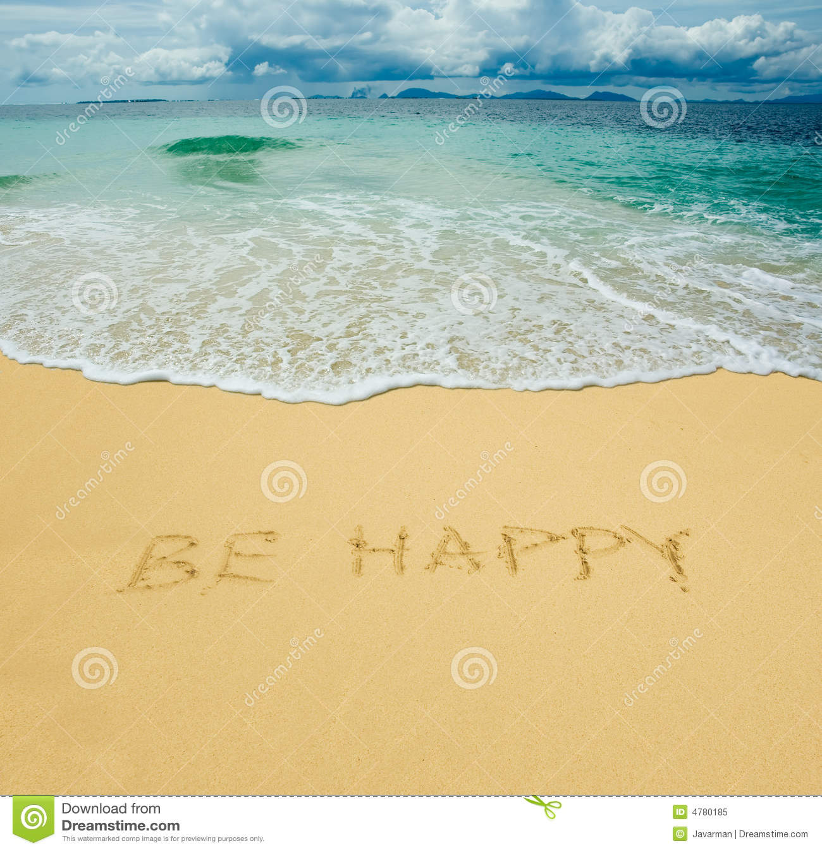 Soyez heureux écrit dans un sable