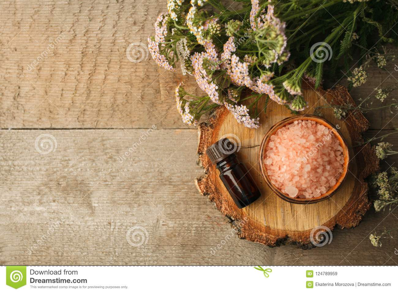 Spa composition on wooden table. Natural aroma oil, sea salt on rustic wooden background. Healthy skin care. SPA concept. Top view