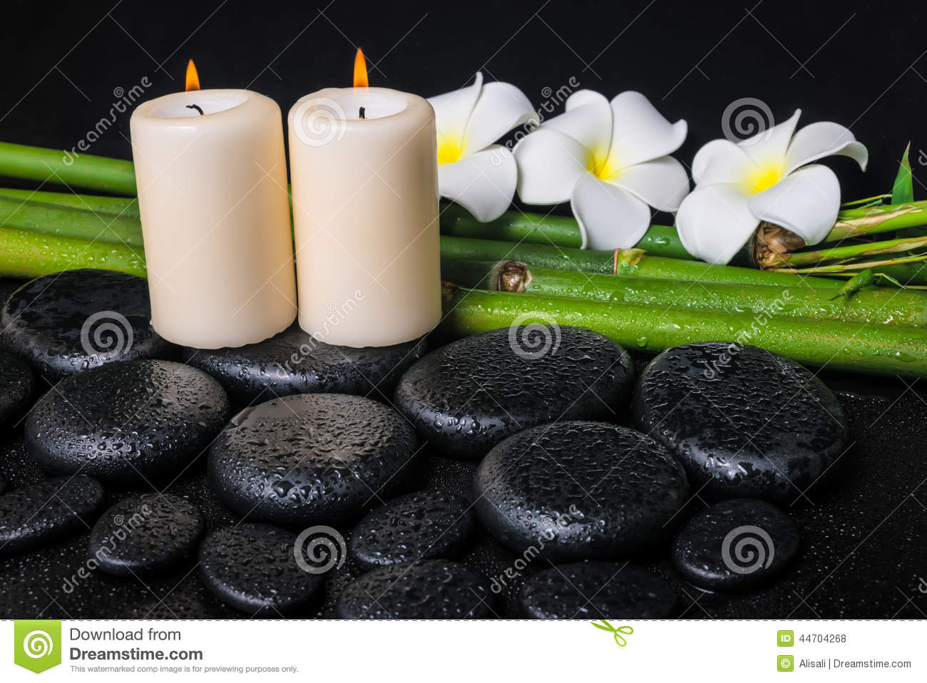 Spa concept of zen basalt stones, three white flower frangipani