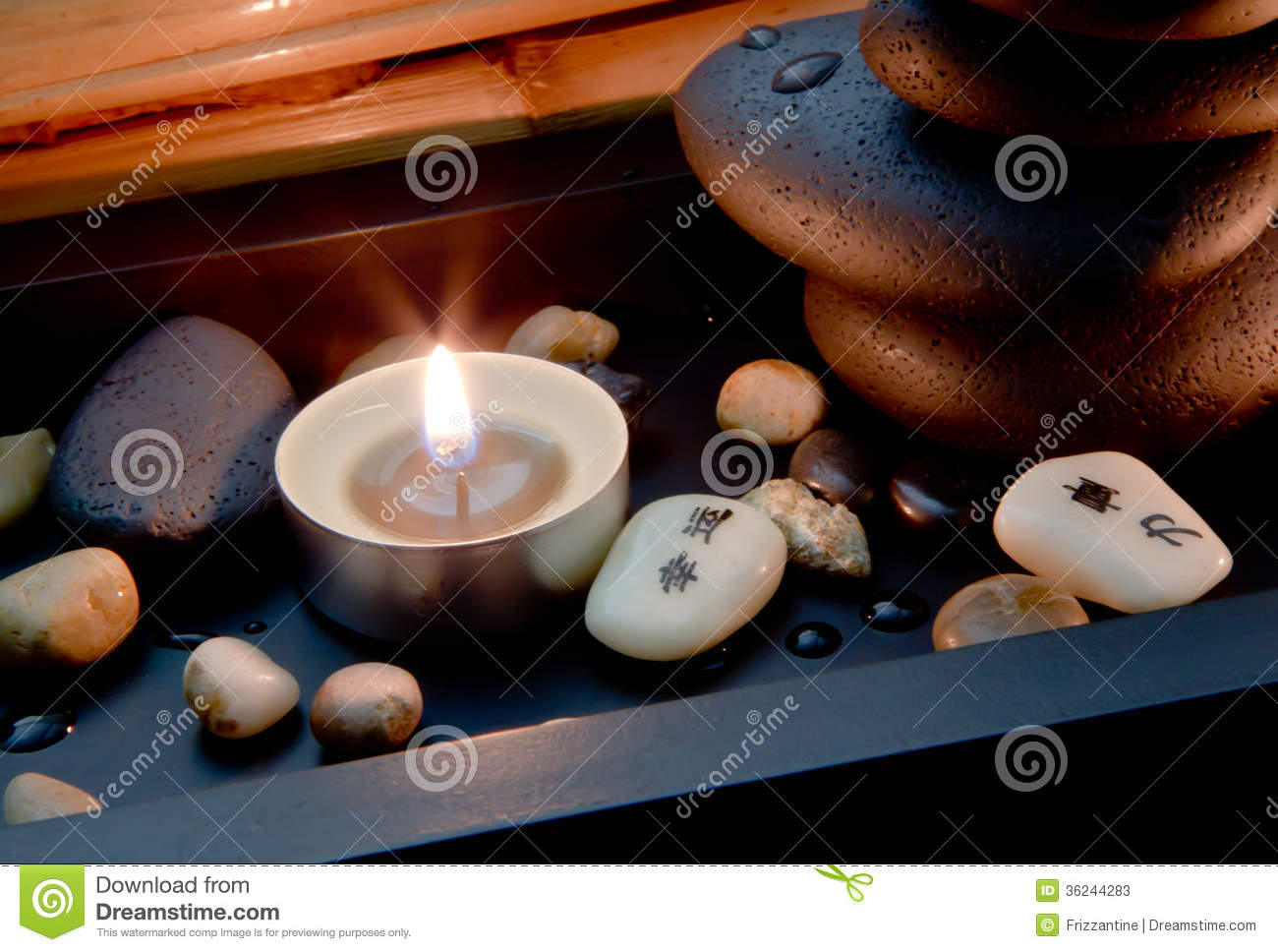 spa decoration in asian style with stones and candle stock photos
