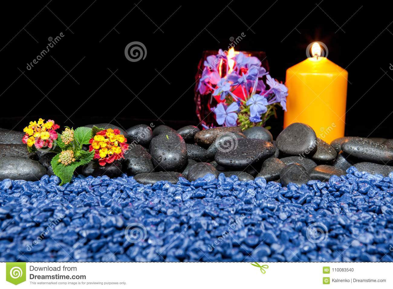 spa decoration with stones and candles on a black background stock