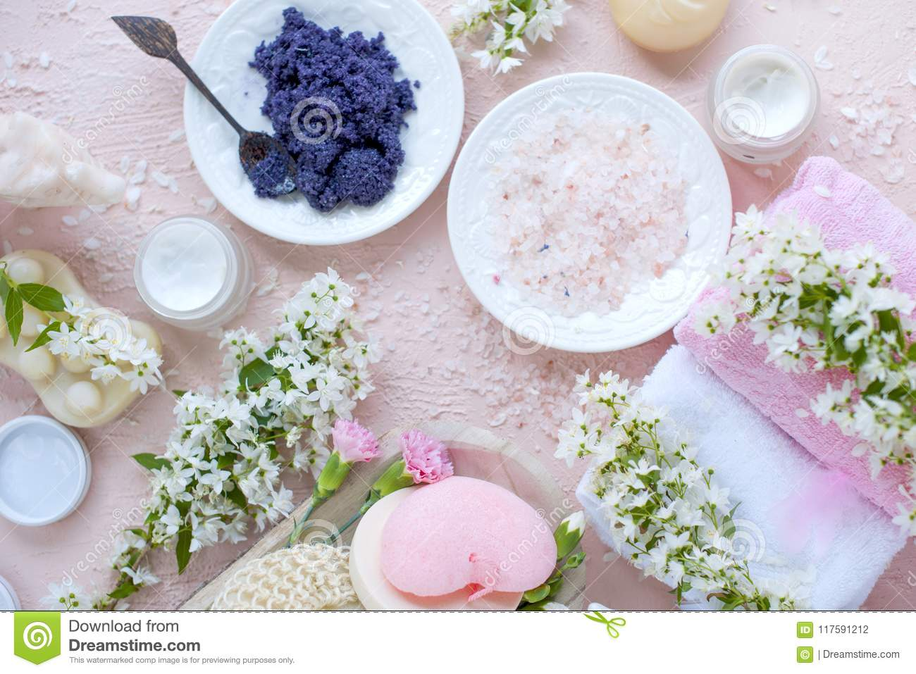 Spa different cosmetics for care and beauty pink background and different cosmetics for care and beauty pink background and white flowers mightylinksfo