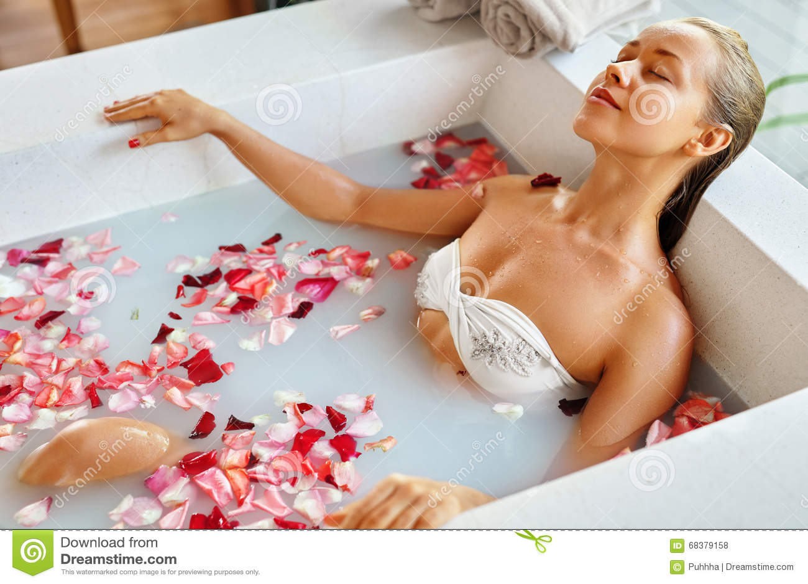 da619c6670995 spa-relaxation-woman-body-care-flower-bath-beauty-skincare-beautiful -sexy-caucasian-blonde-girl-bikini-lying-resort-day-68379158.jpg