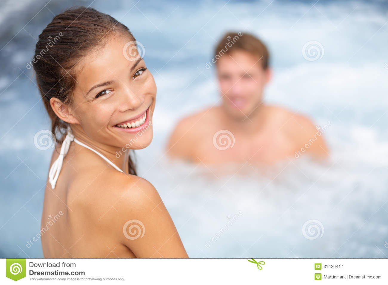 Spa resort jacuzzi hot tub couple, woman and man