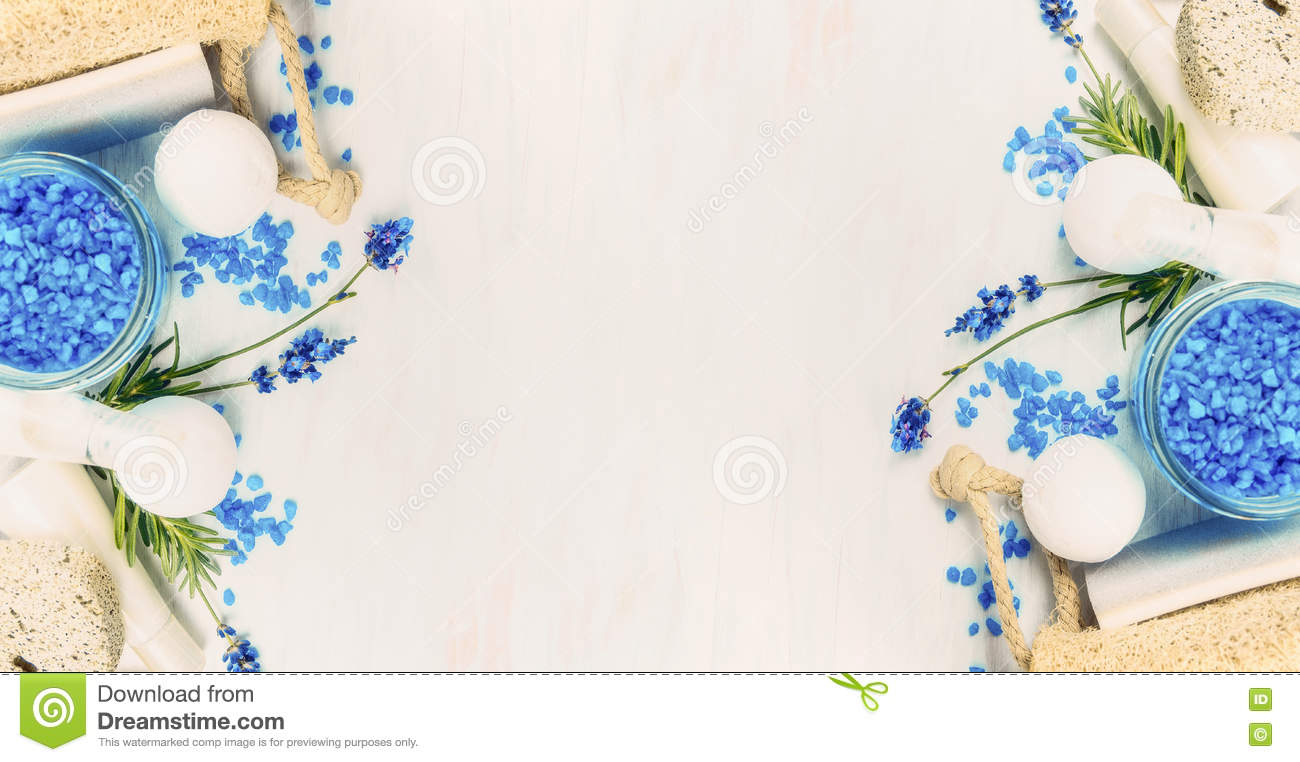 Spa setting with Lavender flowers, sea salt and wellness tools on light background, top view