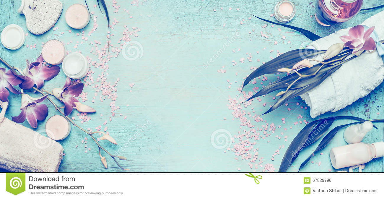 Spa setting with orchid flowers and body care and cosmetic tools on shabby chic turquoise background, top view, banner.
