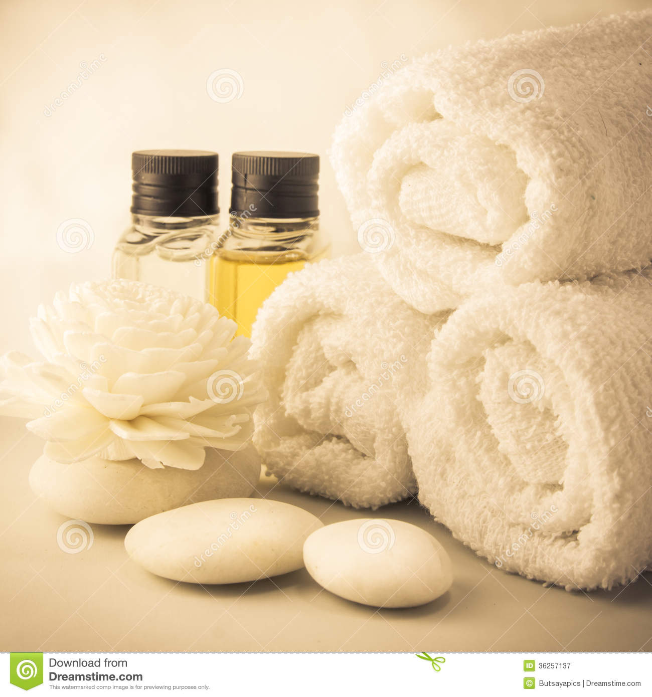 Spa setting with towels in bath room royalty free stock photography
