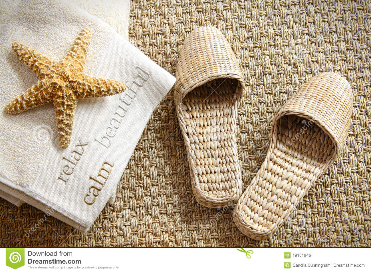 Spa Slippers On Seagrass Carpet With Towels Stock Photo