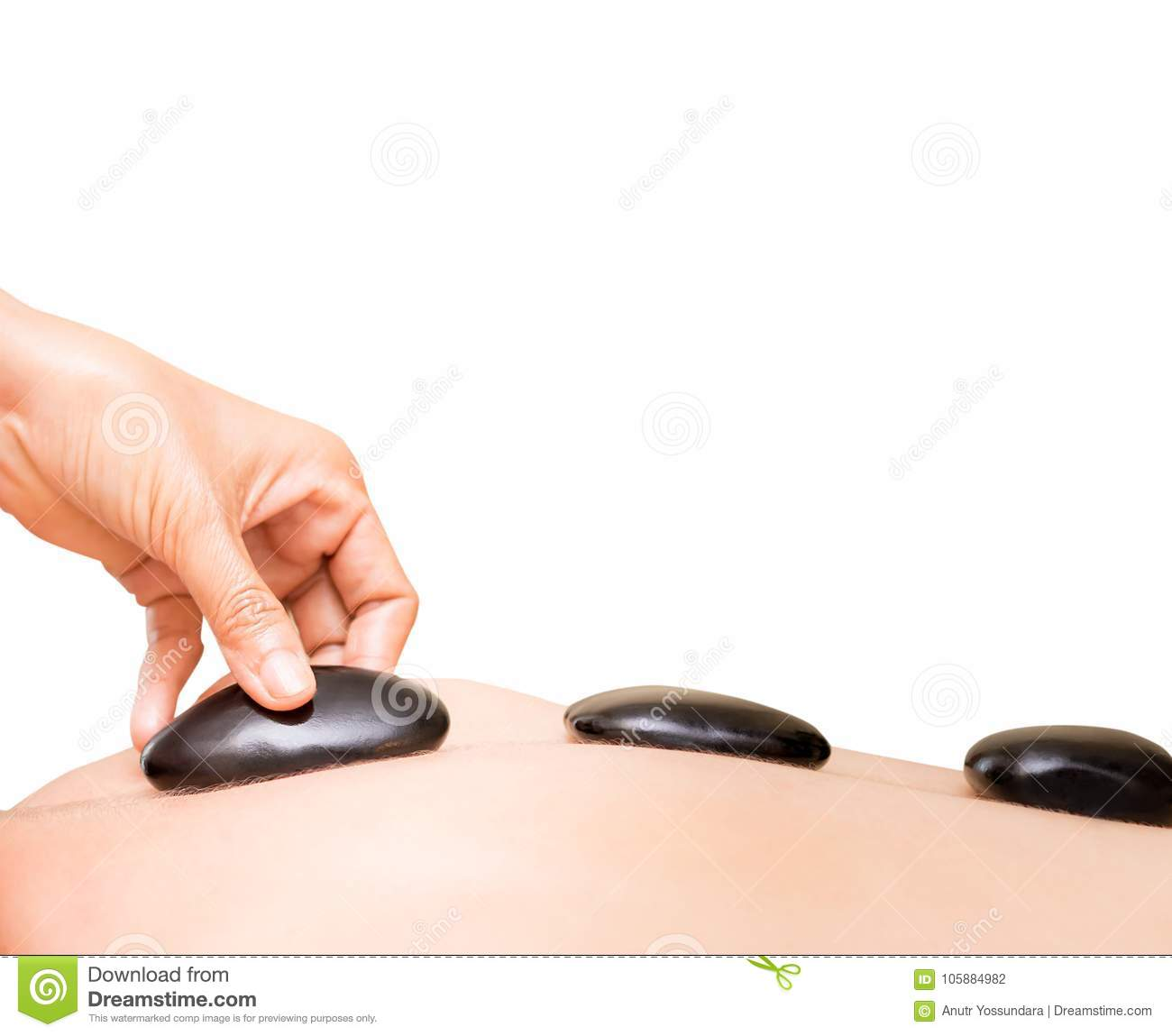Spa Therapist Hand Is Placing Black Hot Stone On Women ...