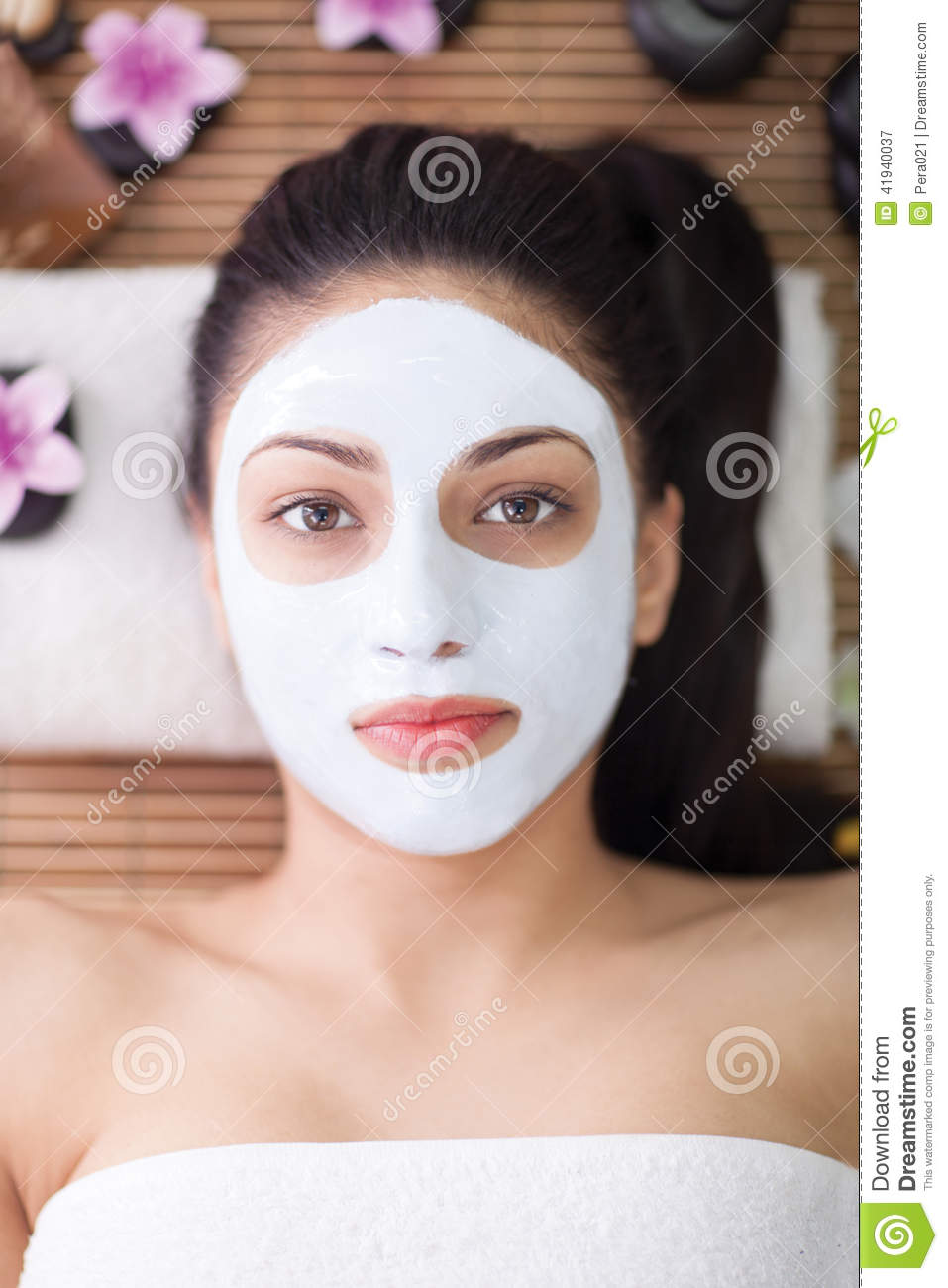 Spa therapy for young woman having facial mask at beauty for Salon younga