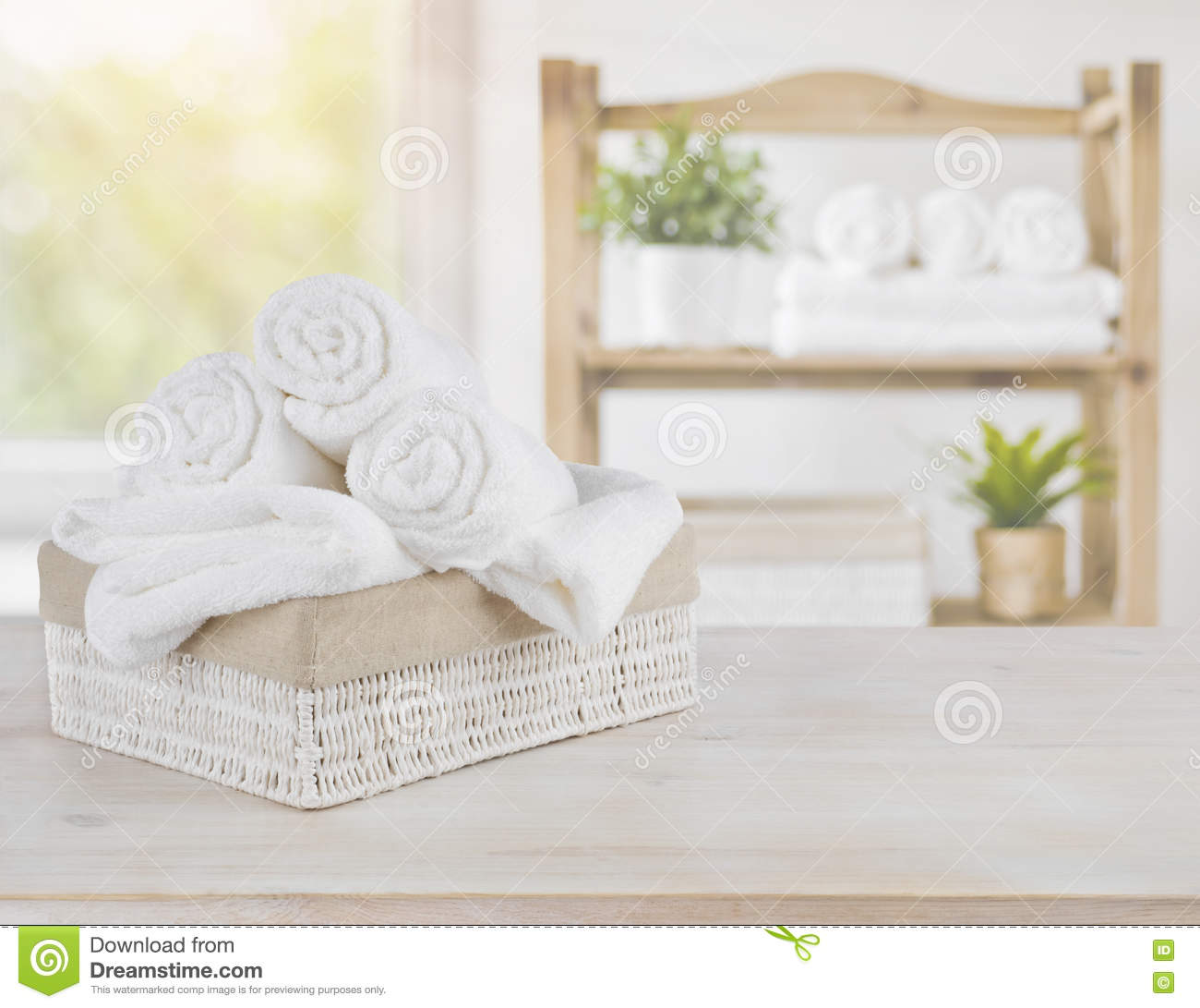Spa towels on wood over abstract beauty salon room for Abstract beauty salon