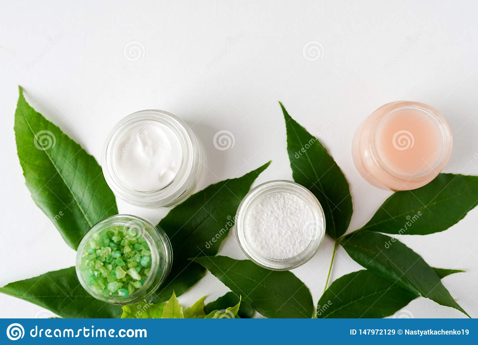 Spa treatment concept, flat lay natural cosmetic products mask, gel, salt view from above, space for a text . white background