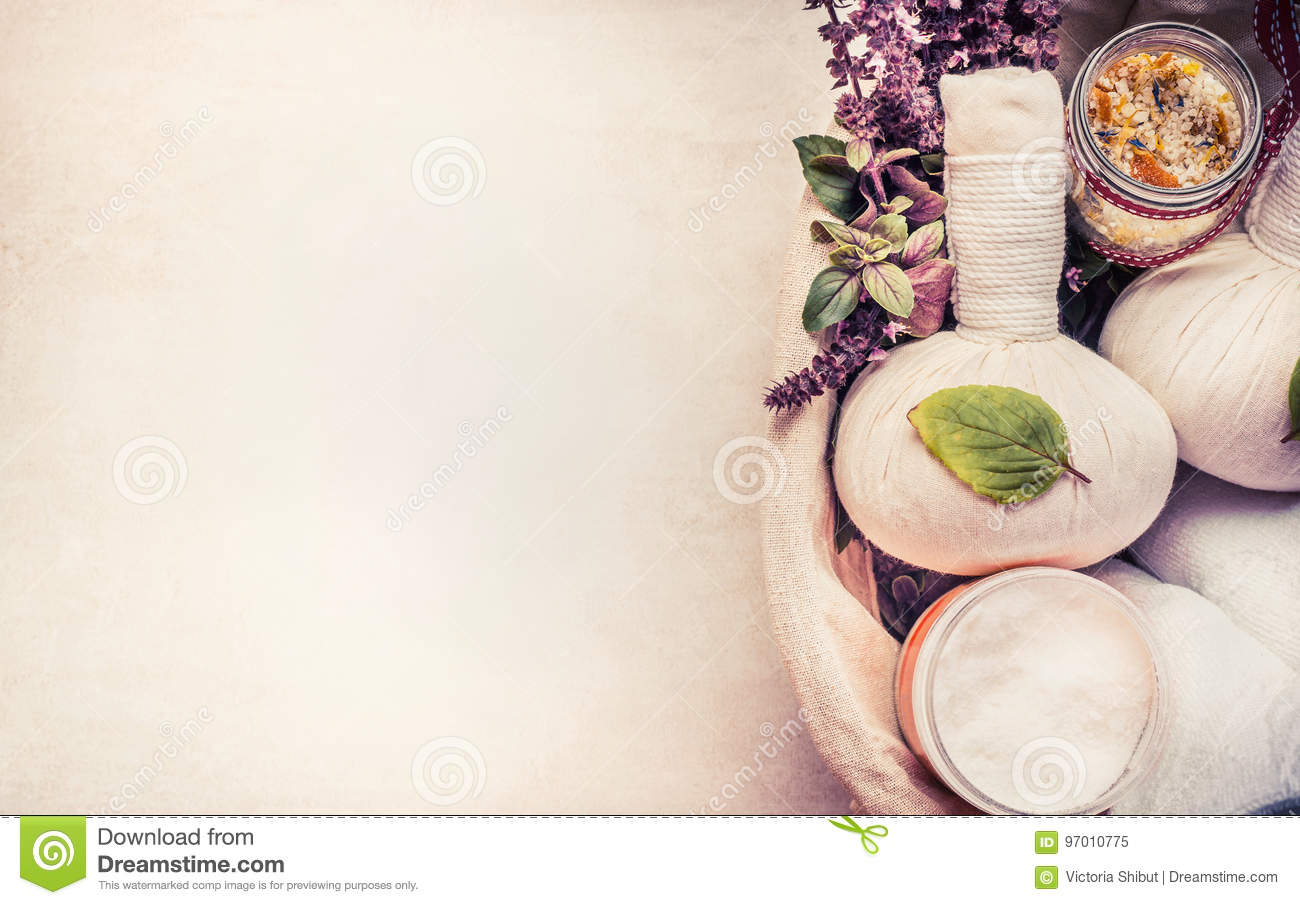 Spa or wellness background with herbal equipment for massage and relaxing treatment