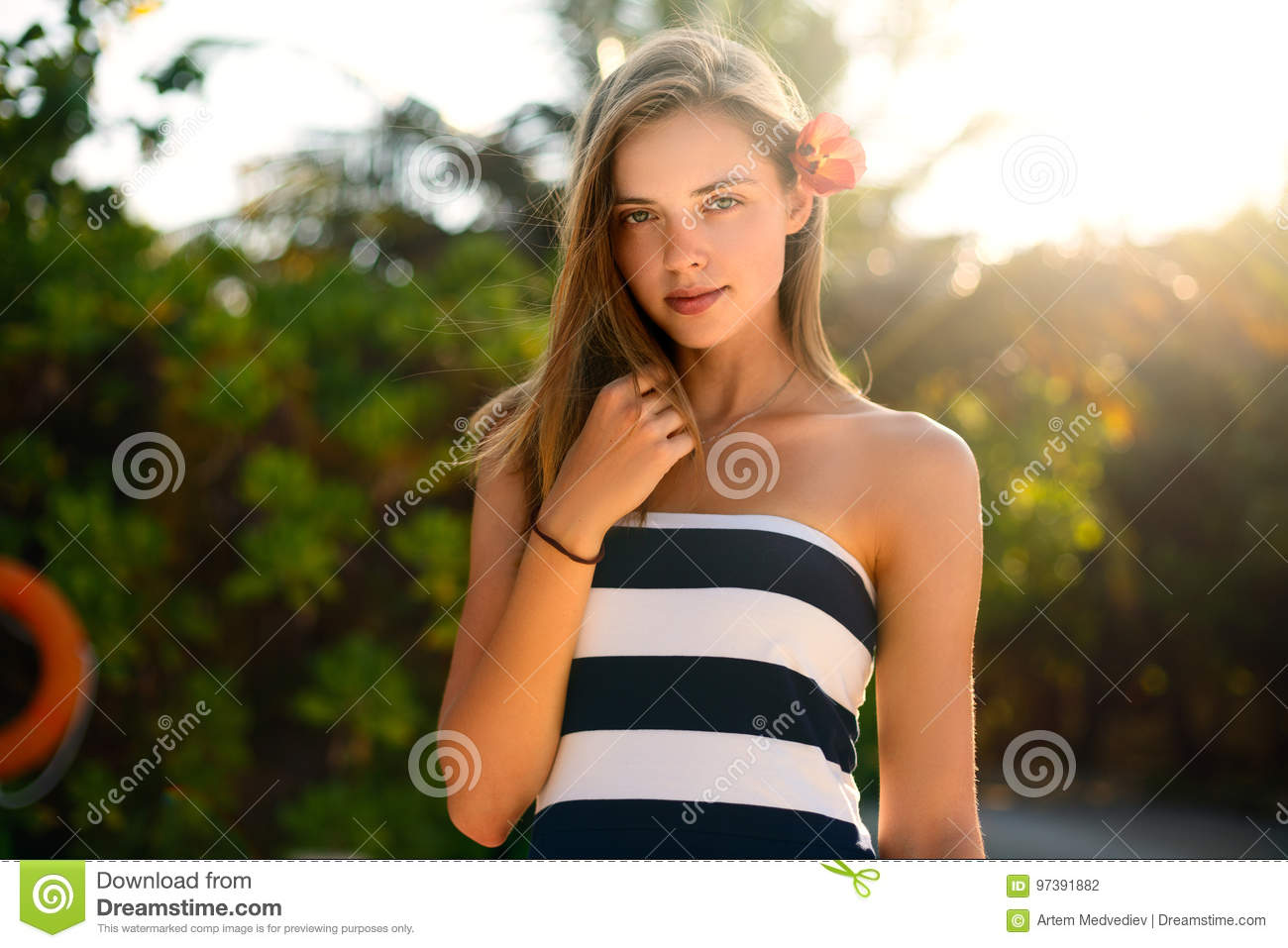 Spa wellness beach beauty woman relaxing andlooking at camera on beach. Beautiful serene and peaceful young female model