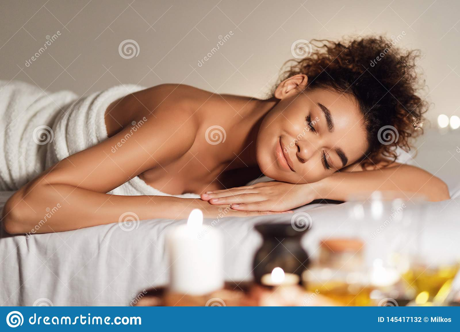 Spa and wellness. Woman relaxing with aroma composition