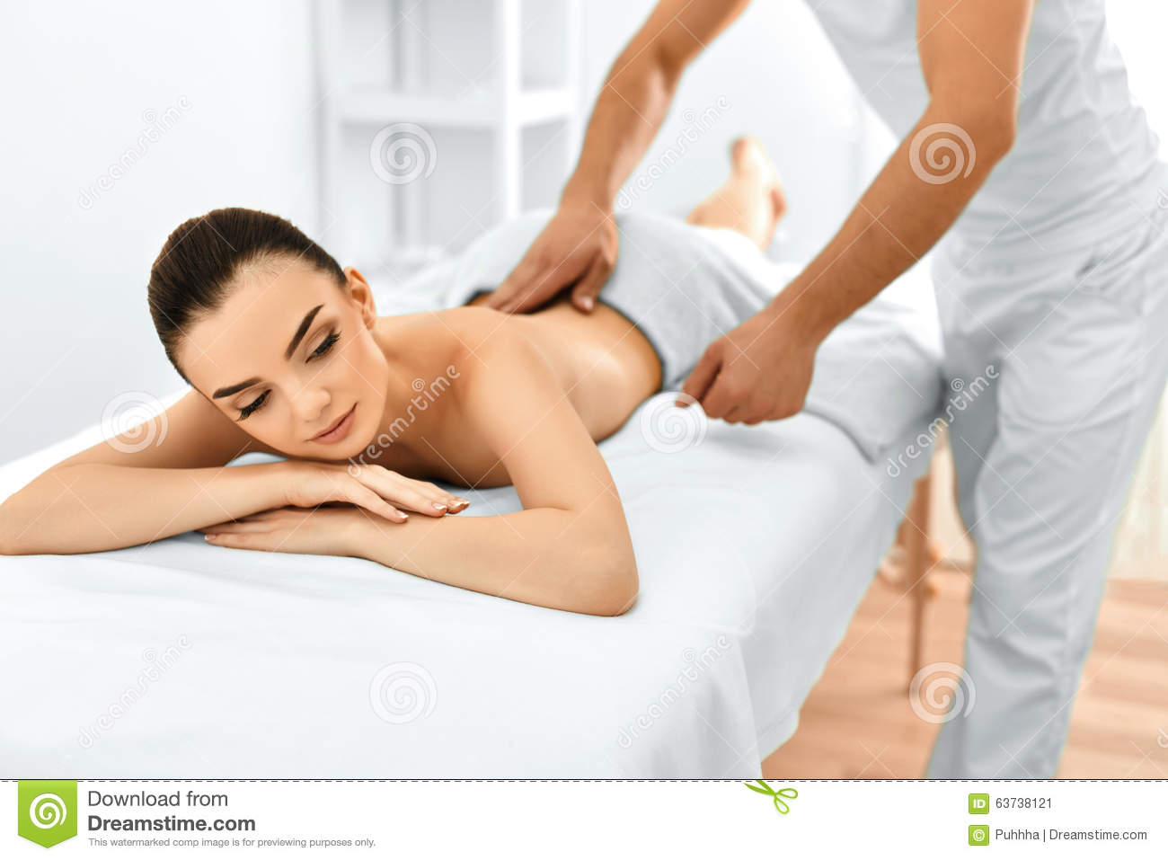 Nice male body gets a massage